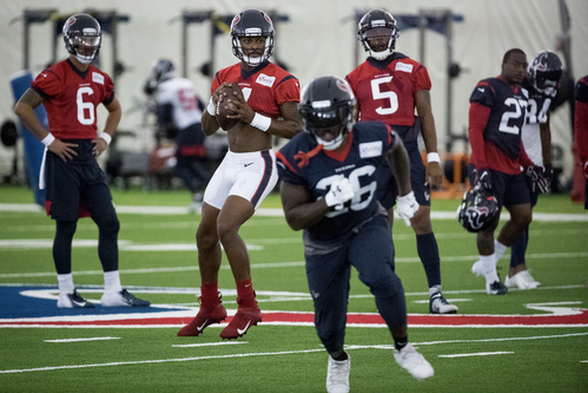Houston Texans quarterback Deshaun Watson (4) drops back to throw a pass to running back Lamar Miller (26) during training camp at the Methodist Training Center on Thursday, Aug. 22, 2019, in Houston.