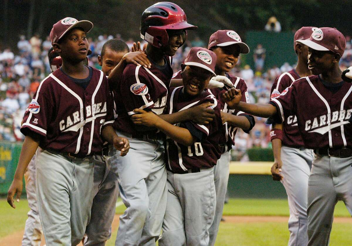 Willemstad, Curacao, Netherlands Antilles' Jurickson Profar is congratulated by teamates after hitting a two run blast during the first inning against Thousnd Oaks, California, at the Little League World Series Championship in Williamsport, PA, on Sunday.