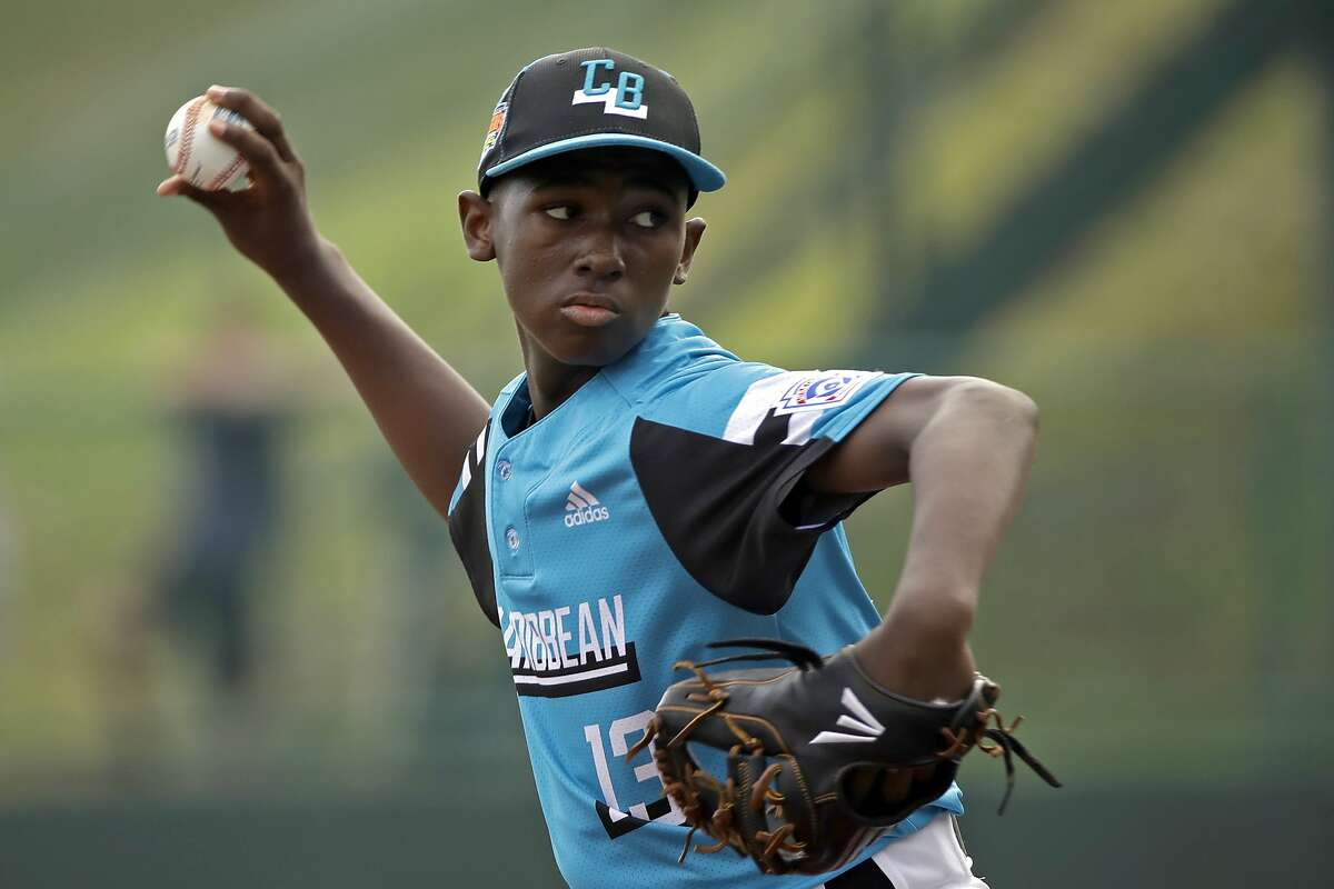 Curacao's starting pitcher Jurdrick Profar (13) delivers a pitch against South Korea in the first inning an International pool play baseball game at the Little League World Series tournament in South Williamsport, Pa., Sunday, Aug. 18, 2019.South Korea won the game 4-0. (AP Photo/Tom E. Puskar)