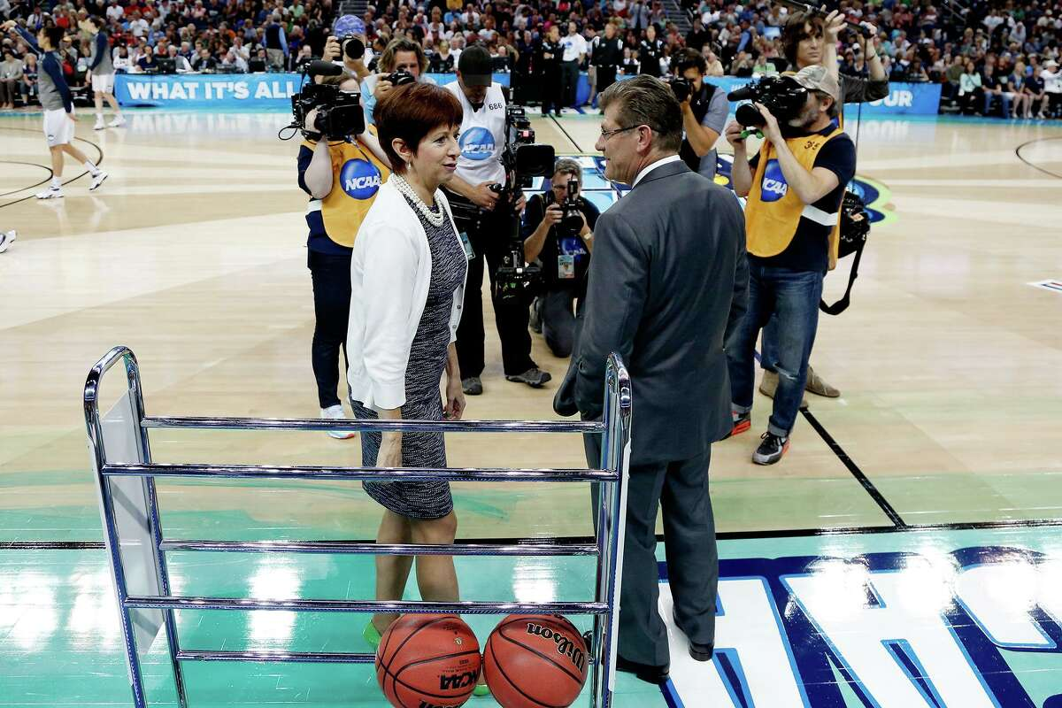 Notre Dame coach Muffet McGraw, left, and UConn coach Geno Auriemma meet prior to the start of the National Championship game at Amalie Arena in Tampa, Fla., on April 7, 2015.