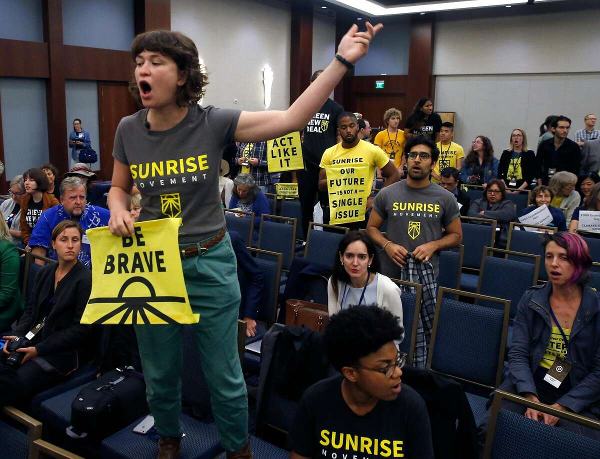 Muriel MacDonald interrupts a meeting of the Resolutions Committee during the DNC summer meeting at the Hilton Hotel after the group voted down a request for a call for a presidential candidate debate on climate change in San Francisco, Calif. on Thursday, Aug. 22, 2019.