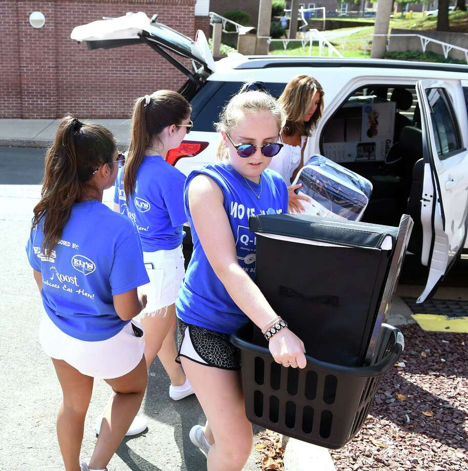 Sophomore Maeve Caine (right) and other students in the Move-In Crew assist freshmen move their belongings into dorm rooms at Quinnipiac University's  Dana English Hall in Hamden on August 22, 2019. Photo: Arnold Gold, Hearst Connecticut Media / New Haven Register
