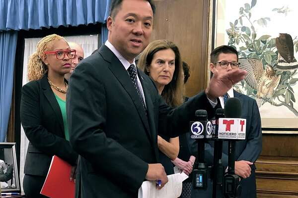 Connecticut Attorney General William Tong speaks in his office, Wednesday, Aug. 21, 2019, in Hartford, Conn., about the potential impact on thousands of state residents by planned rule changes for public benefits for immigrants.