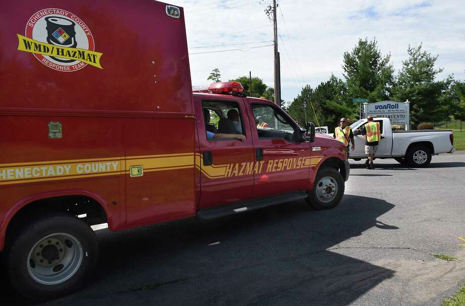 A hazmat truck turns on to Von Roll Dr. on Thursday, Aug. 22, 2019 in Rotterdam, N.Y. The road was closed to anybody except employees that worked on the street but were told to stay in parking lot. (Lori Van Buren/Times Union) Photo: Lori Van Buren, Albany Times Union
