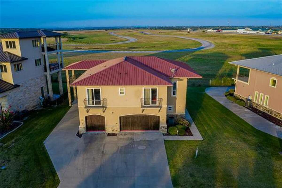 Check out this house in Cresson, Texas (just outside of DFW) that has a massive road course/race track in the backyard.