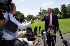 President Donald Trump has an exchange with NBC News White House correspondent Peter Alexander, left, while speaking with reporters before departing on Marine One on the South Lawn of the White House, Aug. 21, 2019, in Washington. Trump is headed to Kentucky.