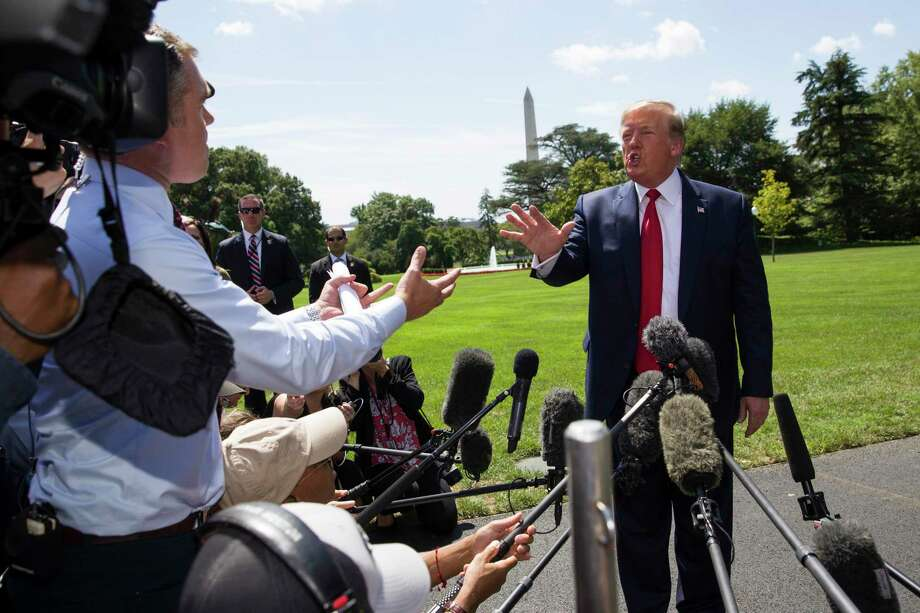 President Donald Trump has an exchange with NBC News White House correspondent Peter Alexander, left, while speaking with reporters before departing on Marine One on the South Lawn of the White House, Aug. 21, 2019, in Washington. Trump is headed to Kentucky. Photo: Alex Brandon / Associated Press / Copyright 2019 The Associated Press. All rights reserved.