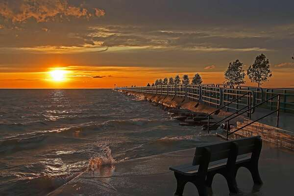 Moderate winds and warm temperatures greeted visitors at the breakwall in Caseville, as the sun set over Saginaw Bay on a recent summer evening.