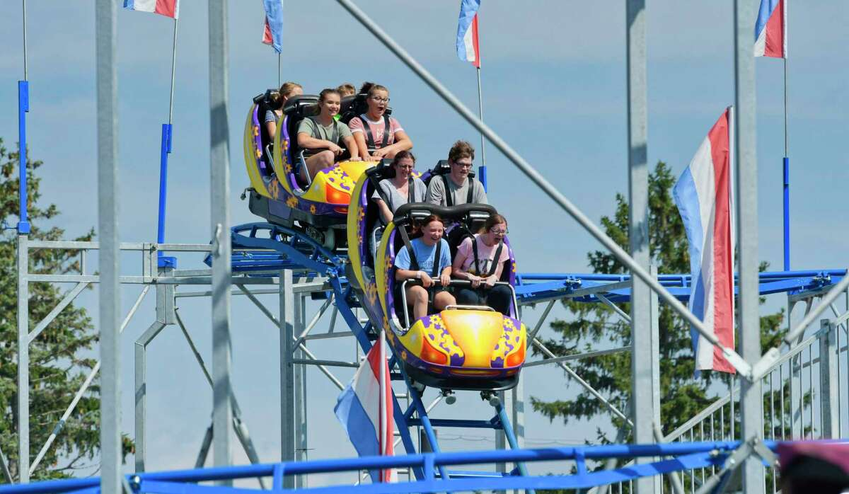 Kids ride a roller coaster during opening day of the Schaghticoke Fair on Wednesday, Aug. 29, 2018, in Schaghticoke, N.Y. (Paul Buckowski/Times Union)