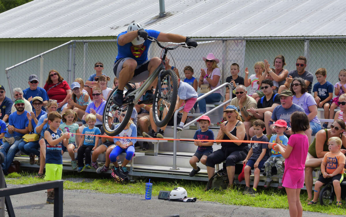 Craig Wright of the Bike Stunt Show jumps his bicycle during his show at the Washington County Fair on Thursday, Aug. 22, 2019, in Greenwich, N.Y. (Paul Buckowski/Times Union)