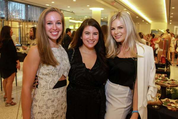 EMBARGOED FOR SOCIETY REPORTER UNTIL AUGUST 25 Jessica Feist, from left, Lisa Braud and Ashley Gangnuss at the Dress for Success' young professionals group, Women of Wardrobe annual Sizzling Summer Soiree at Tootsies on August 21.