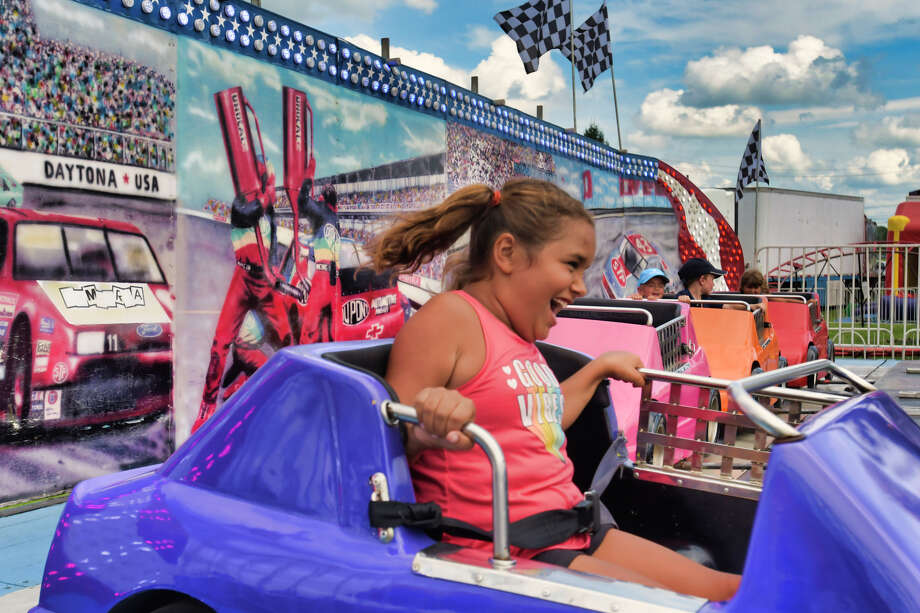 Olivia Garay, 9, of Cohoes is swung around on the children's NASCAR ride at the Washington County Fair on Thursday, Aug. 22, 2019, in Greenwich, N.Y.     (Paul Buckowski/Times Union) Photo: Paul Buckowski, Albany Times Union / (Paul Buckowski/Times Union)