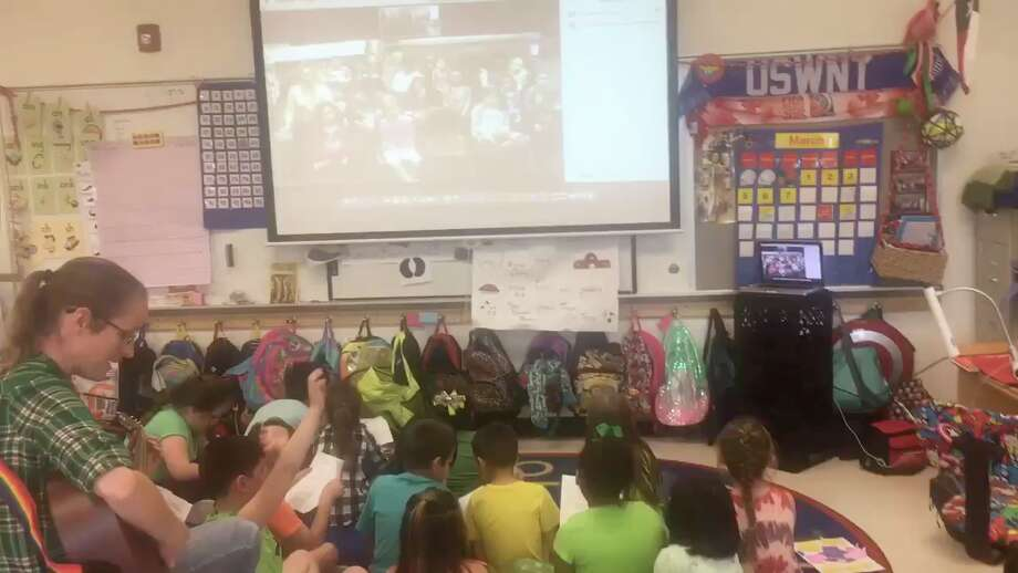A'ndrea Fisher sits with her 1st grade class at Freiheit Elementary in New Braunfels as they hold a video conference with 1st graders at a school in Kamploos, British Columbia, Canada in 2017. Fisher, who now teaches middle school students, said she fosters curiosity to ensure her students become problem solvers in life. Photo: Courtesy: A'ndrea Fisher