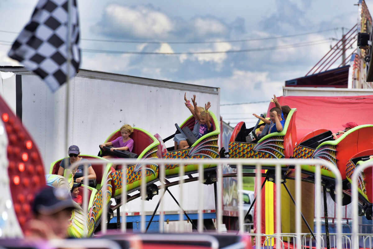 Children ride a roller coaster at the Washington County Fair on Thursday, Aug. 22, 2019, in Greenwich, N.Y. The Washington County Fair said May 13, 2021 that it will reopen for the season after the pandemic. But said the state still needs to tell them how to operate.(Paul Buckowski/Times Union)