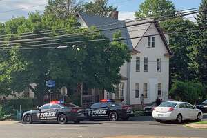Police units block off the intersection of Boston Avenue and Remington Street in Bridgeport, Conn., on Thursday, Aug. 22, 2019, after a male victim was shot on Remington Street around 3:30 p.m.