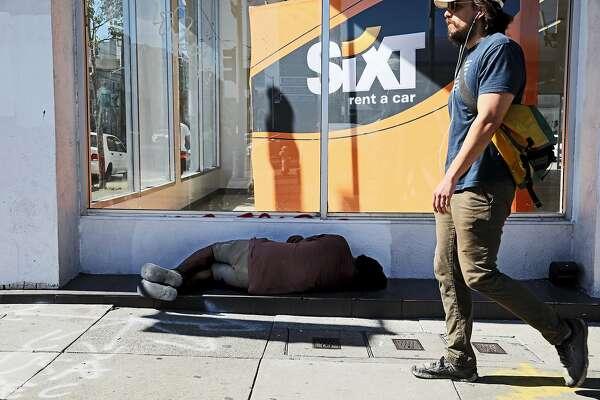A homeless man sleeps at 2898 16th St. in San Francisco, Calif., on Tuesday, June 18, 2019. Shot at 2898 16th St. at 4:49 PM.