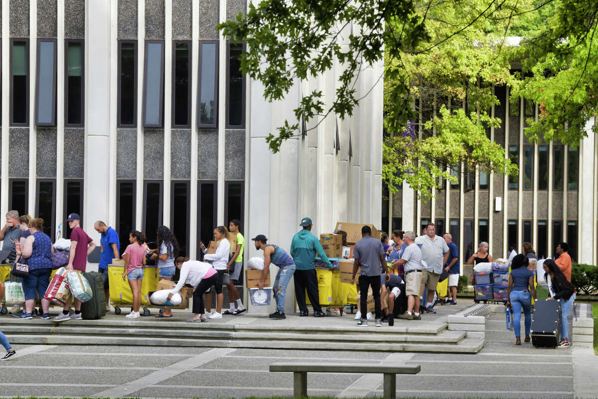 University at Albany freshman students along with their family members wait in line outside one of the dorm towers during move-in day on Thursday, Aug. 22, 2019, in Albany, N.Y. (Paul Buckowski/Times Union)