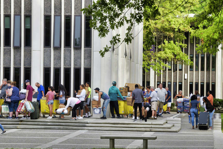 University at Albany freshman students along with their family members wait in line outside one of the dorm towers during move-in day on Thursday, Aug. 22, 2019, in Albany, N.Y.     (Paul Buckowski/Times Union) Photo: Paul Buckowski, Albany Times Union / (Paul Buckowski/Times Union)