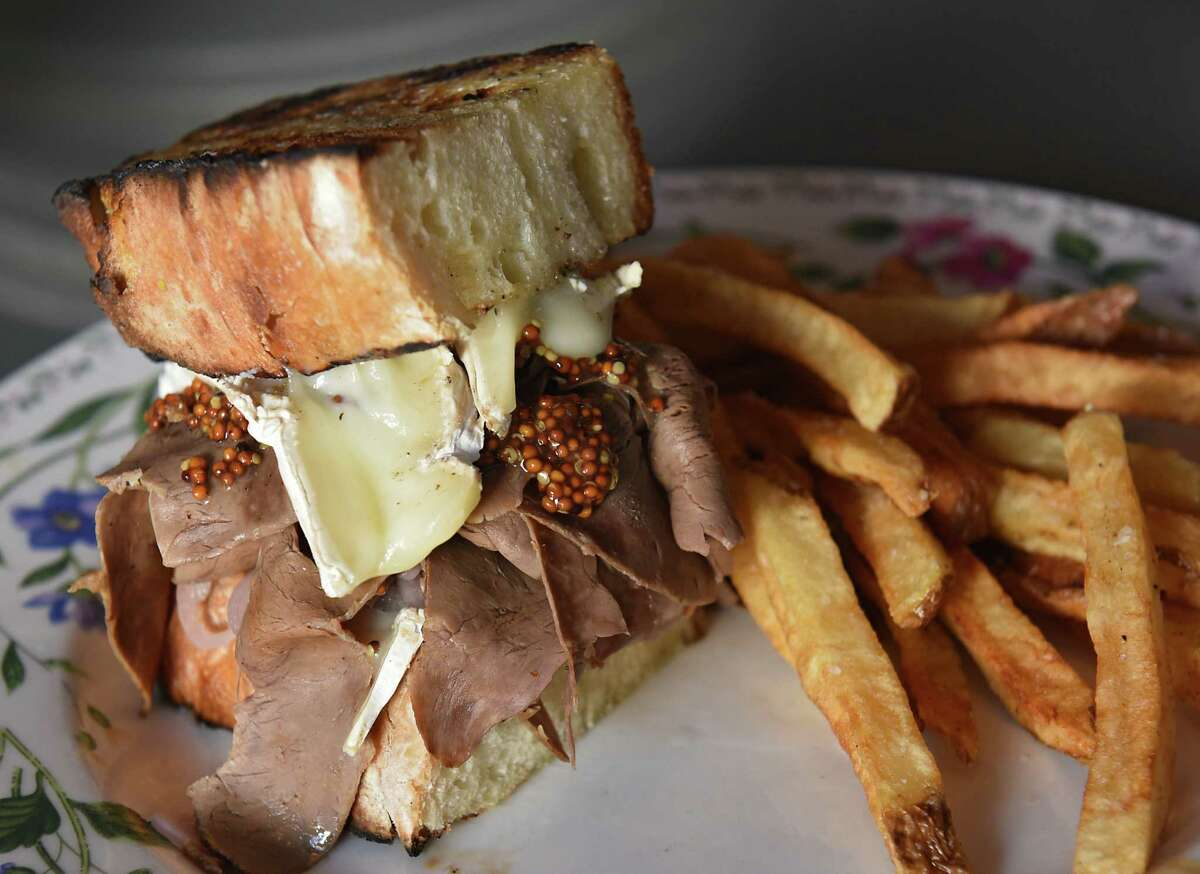 Beef heart pastrami with jalapeno brown butter, roasted brie, toasted sourdough, grilled pickled onion, french fries at Farmacy on Thursday Aug. 15, 2019 in Glens Falls, N.Y. (Lori Van Buren/Times Union)