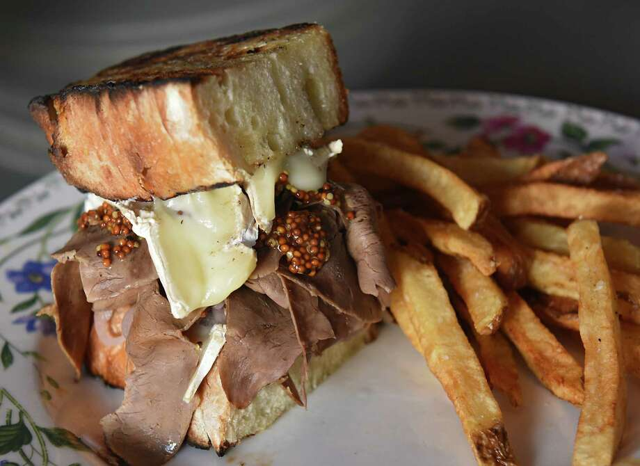 Beef heart pastrami with jalapeno brown butter, roasted brie, toasted sourdough, grilled pickled onion, french fries at Farmacy on Thursday Aug. 15, 2019 in Glens Falls, N.Y. (Lori Van Buren/Times Union) Photo: Lori Van Buren / 20047651A