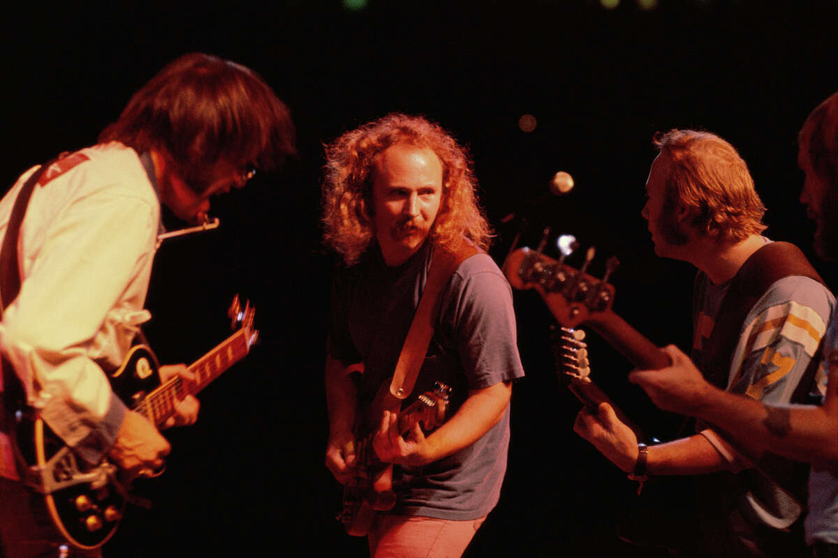 From left, Neil Young, David Crosby, Stephen Stills and Tim Drummond during a 1974 Crosby, Stills, Nash & Young concert in Texas. MUST CREDIT: Handout courtesy of Joel Bernstein/Sony Pictures Classics