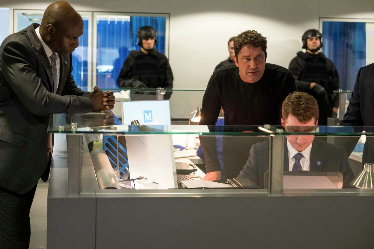 This image released by Lionsgate shows Lance Reddick, left, and Gerard Butler in