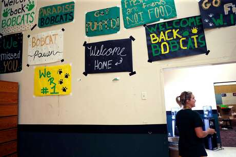 Athletic Director Anne Stearns walks through the Paradise High gym where the walls sport good wishes for the team. Photo: Scott Strazzante / The Chronicle