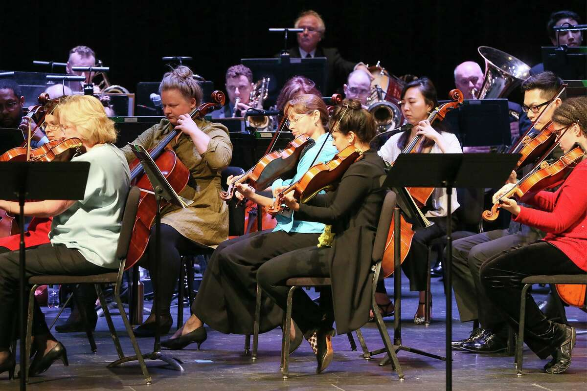 The musicians of the San Antonio Symphony - shown performing for Judson ISD elementary schools in May - have a new three-year contract.