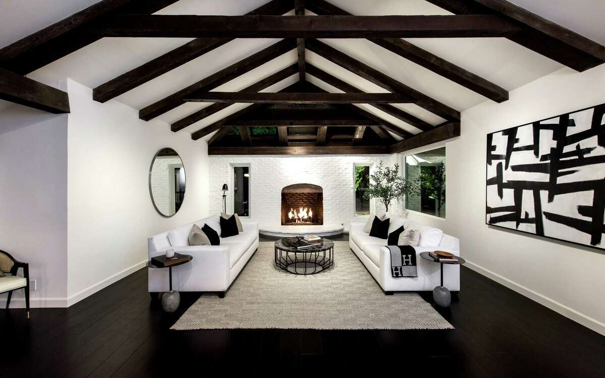 """The sprawling ranch-style home in Encino was home to Oscar-winning filmmaker Ron Howard in the late 1970s and early '80s, when he was appearing on screen in """"Happy Days."""" Listed for $3.695 million, the Robert Byrd-designed house has been renovated and modernized. Crisp white walls, exposed beams and four fireplaces are among features. The kitchen has been modernized. (Unlimited Style Real Estate Photography)"""