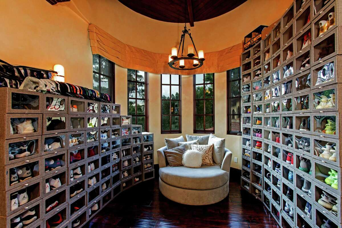 The Encino home of former Dodger Milton Bradley, listed for $3.799 million, sits on more than a third of an acre in the Amestoy Estates neighborhood. The 7,500-square-foot home opens two a two-story living room with a floor-to-ceiling place. A catwalk sits above the living room, connecting second living spaces. Outside, Bradley's backyard includes a swimming pool with a waterfall feature, a barbecue pavilion and a fire pit. (Keller Williams Realty)