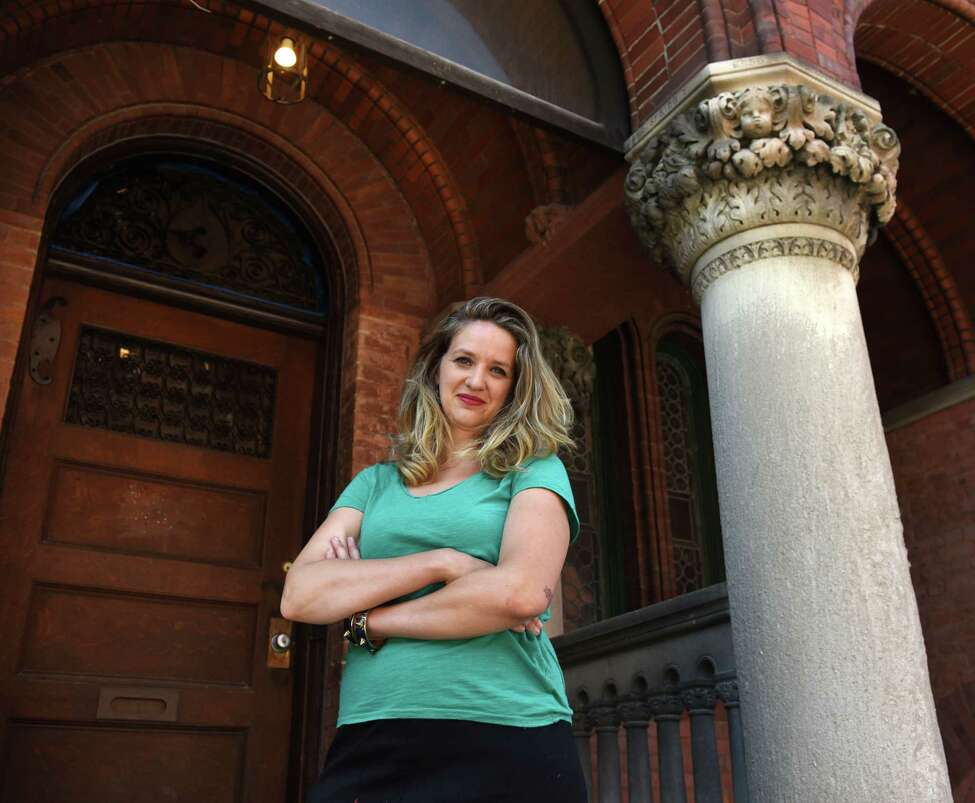 Emily Menn, a Troy real estate developer and landlord, is pictured outside one of her properties on Tuesday, Aug. 20, 2019, in Troy, N.Y. (Will Waldron/Times Union)