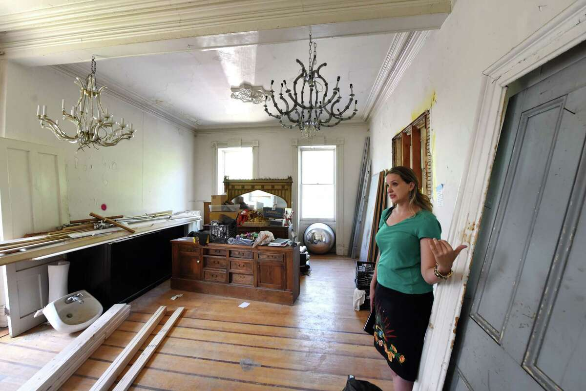 Emily Menn, a Troy real estate developer and landlord, is pictured inside her apartment, which she is restoring on Tuesday, Aug. 20, 2019, in Troy, N.Y. (Will Waldron/Times Union)