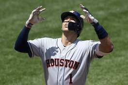Houston Astros' Carlos Correa celebrates his three-run home run during the second inning of a baseball game against the Baltimore Orioles, Sunday, Aug. 11, 2019, in Baltimore. (AP Photo/Nick Wass)