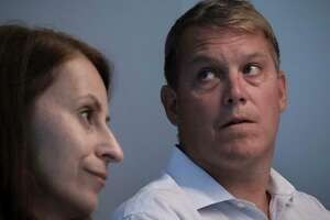 Scott Hapgood, right, a U.S. financial adviser charged with killing a hotel worker while on vacation in Anguilla, and his lawyer Juliya Arbisman, left, hold a press conference, Tuesday, Aug. 20, 2019, in New York. The case has sparked racial tensions on the Caribbean island that caters to wealthy tourists, and some Anguillans are demanding that Hapgood return to face justice in the British territory of nearly 15,000 people. (AP Photo/Bebeto Matthews)