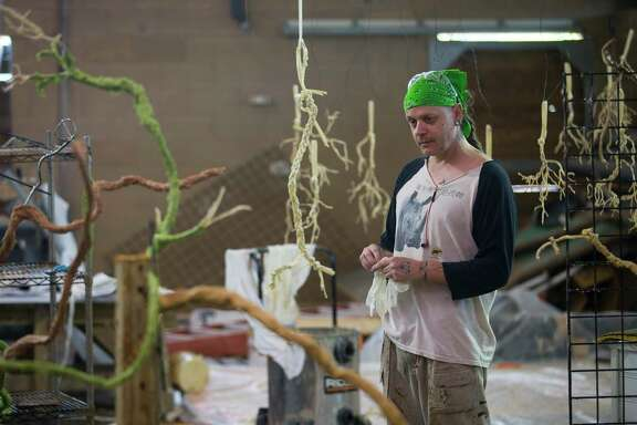 Exhibit artist Nathan Dean works on creating synthetic roots that will comprise parts of the future South American Pantanal exhibit at the Houston Zoo, Thursday, July 11, 2019. New exhibits including the Pantanal, which is a tropical wetland, and a Galapagos Island exhibit are part of a master plan for the zoo's upcoming centennial in 2022. The Pantanal exhibit should be completed by the summer of 2020.