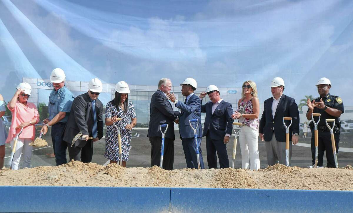 Doggett Industries President and CEO Leslie Dogged and Houston Mayor Sylvester Turner (both, center) take part in the groundbreaking of Doggett Ford $24 million dealership in north Houston Thursday, Aug. 22, 2019, in Houston.