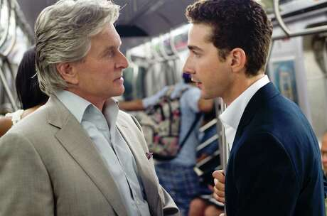 "Michael Douglas, left, shown here with fellow actor Shia LaBeouf, played Gordon Gekko, the movie character in ""Wall Street: Money Never Sleeps,"" whose motto was ""Greed is Good."""