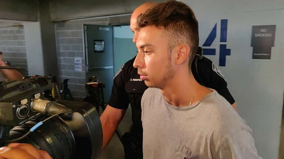 Sebastian Angel Espinar, 20, is charged with capital murder in the death of Andres Gerardo Salinas, 22, according to San Antonio Police. He is seen being escorted by officers to a police vehicle Thursday afternoon, Aug. 22, 2019, in the parking garage of the Public Safety Headquarters, 315 S. Santa Rosa Ave. Photo: Jacob Beltran