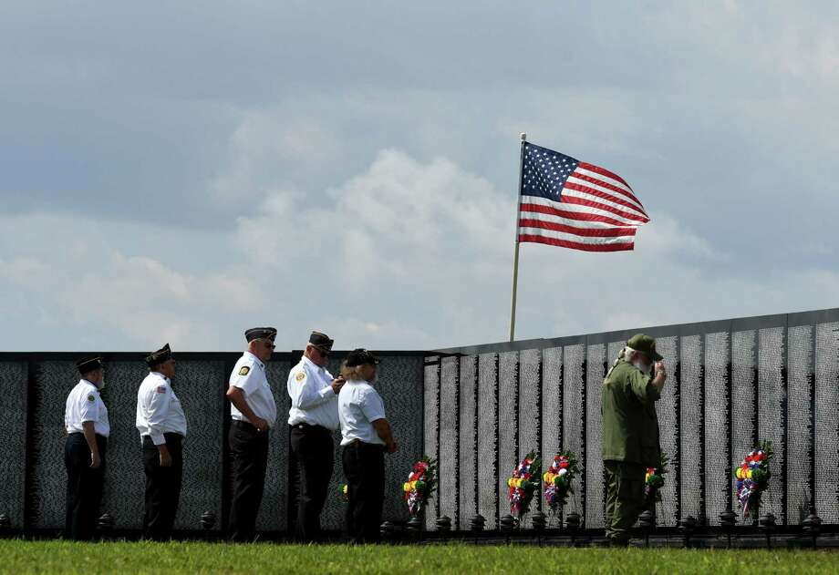 Wreaths are placed at The Vietnam Traveling Memorial Wall during opening ceremonies for the exhibit on Thursday, Aug. 22, 2019, at Dutchmen's Landing in Catskill, N.Y. The wall can be viewed at Dutchmen's Landing through August 26. Catskill is the only scheduled stop for the wall in New York State this year. (Will Waldron/Times Union) Photo: Will Waldron / 40047195A