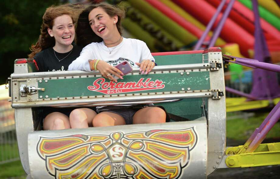 Katie Morris and Sofia Tsiropoulos enjoy the rides during the annual St George Greek Orthodox Church Festival Thursday, August 22, 2019, in Norwalk, Conn. Photo: Erik Trautmann / Hearst Connecticut Media / Norwalk Hour