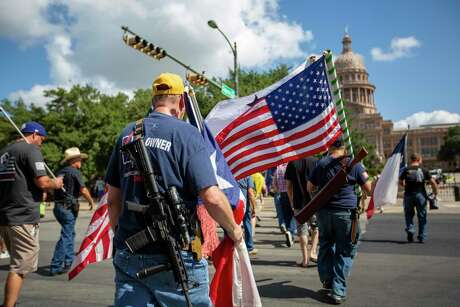 Guns Owners of America marched down Congress Avenue after their news conference at the South Gate of the Texas Capitol on August 22, 2019 in Austin, Texas.