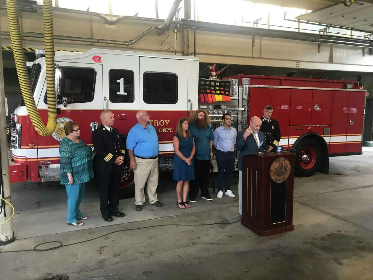 Troy Mayor Patrick Madden stands with city officials in front of the new fire engine the city fire department received Wednesday Aug. 21, 2019.