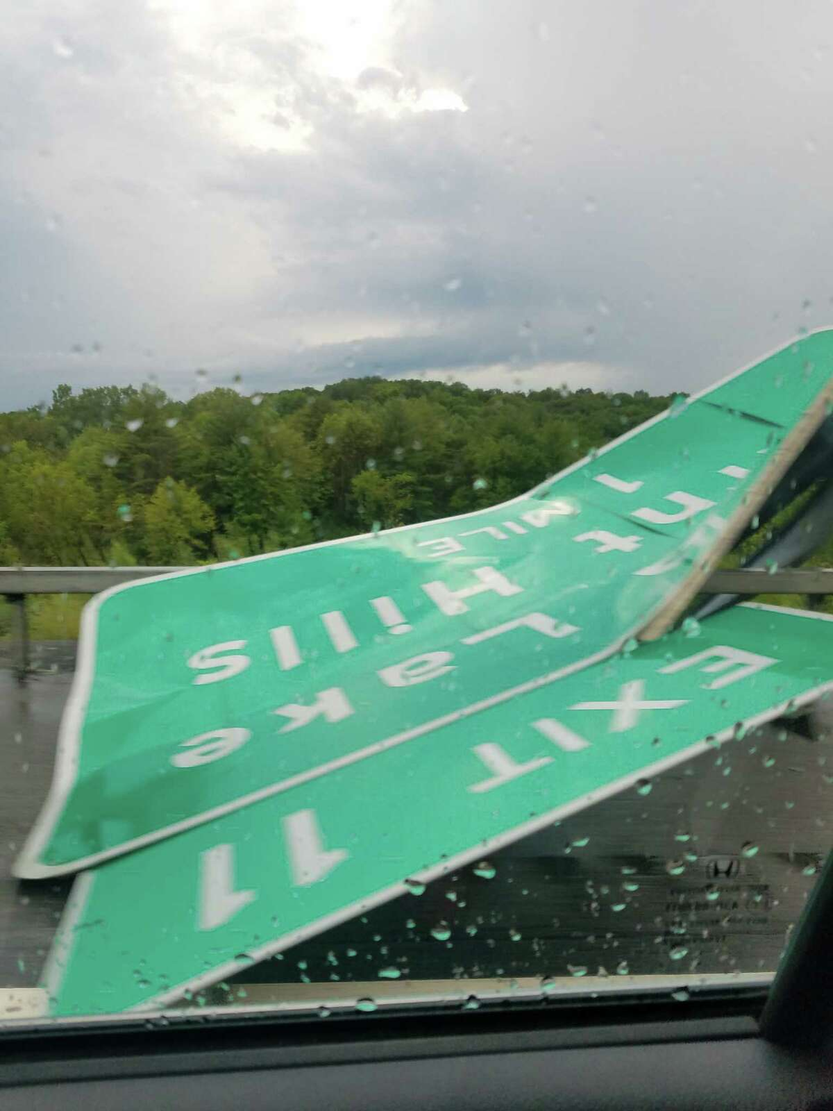 Barbara and Jim LaBate of Clifton Park were driving south on the Northway Sunday night Aug. 18 during the storm when they saw the Exit 11 sign had been hit and twisted into the right lane.