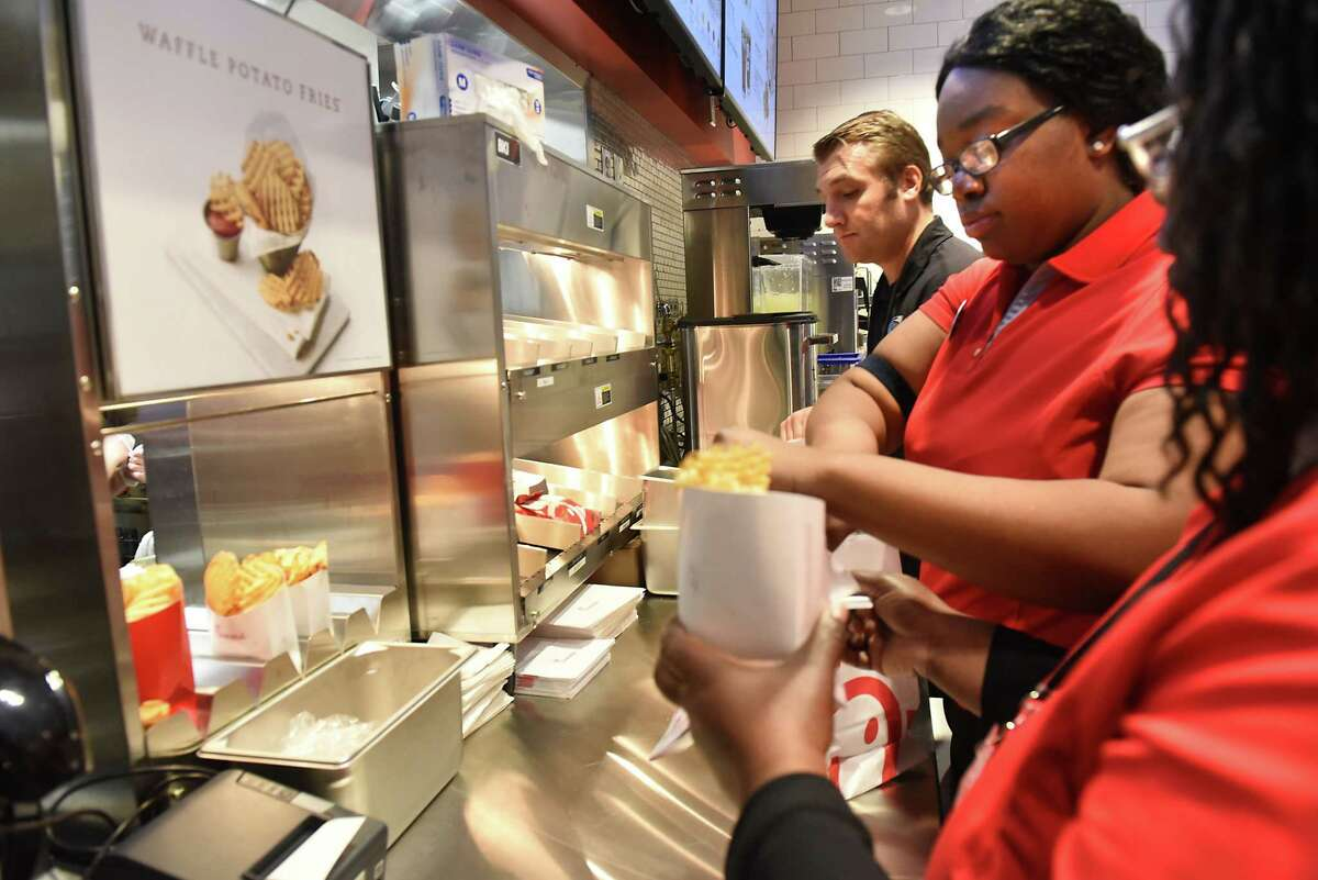 Chick-fil-A employees bag up orders as Albany International Airport hosts a Grand Opening Celebration for the area's first Chick-fil-A on Friday, Oct. 19, 2018 in Colonie, N.Y. (Lori Van Buren/Times Union)
