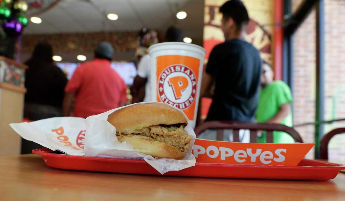 A chicken sandwich sits on a table at a Popeyes as guests wait in line, Thursday, Aug. 22, 2019, in Kyle, Texas. After Popeyes added a crispy chicken sandwich to their fast-fast menu, the hierarchy of chicken sandwiches in America was rattled, and the supremacy of Chick-fil-A and others was threatened. Ita€™s been a trending topic on social media, fans have weighed in with YouTube analyses and memes, and some have reported long lines just to get a taste of the new sandwich. (AP Photo/Eric Gay)