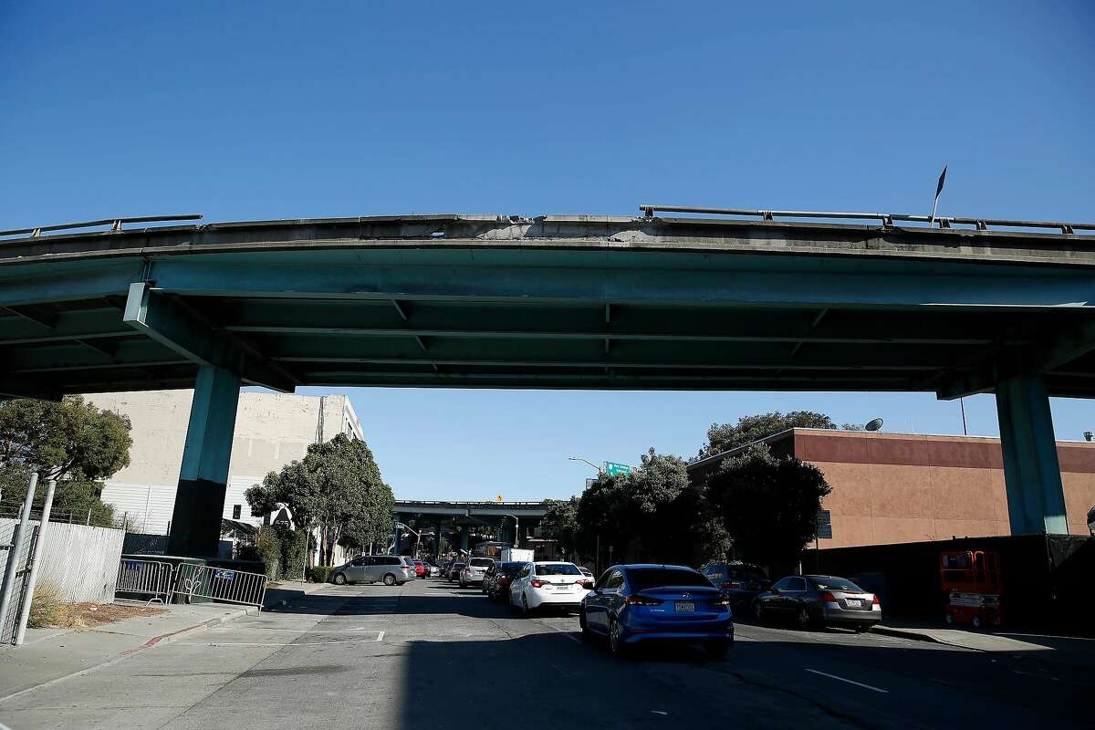 Damage to Highway 101 above 10th Street is seen on Thursday, August, 22, 2019 in San Francisco, CA. A caller had reported that a truck had hit a barrier earlier in the morning.