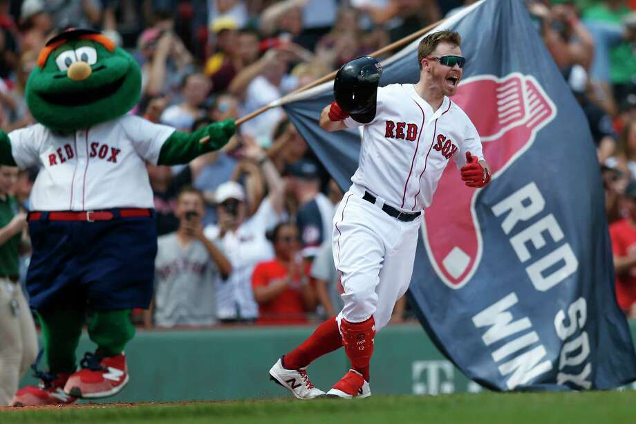 Boston Red Sox's Brock Holt celebrates his game-winning RBI single during the 10th inning of a baseball game against the Kansas City Royals that was suspended by rain with the scored tied on Aug. 8, and continued at Fenway Park in Boston, Thursday, Aug. 22, 2019. (AP Photo/Michael Dwyer) Photo: Michael Dwyer / Copyright 2019 The Associated Press. All rights reserved