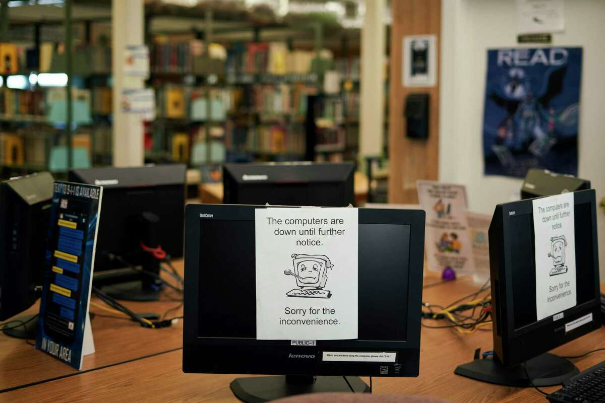 Computers are shut down at the E.M. Gilliam Memorial Library following a ransomeware attack in Wilmer, Texas, Aug. 22, 2019. As hackers lock up networks that power police forces and utilities, municipalities must operate with hobbled computer systems, and decide whether to pay ransoms. (Cooper Neill/The New York Times)