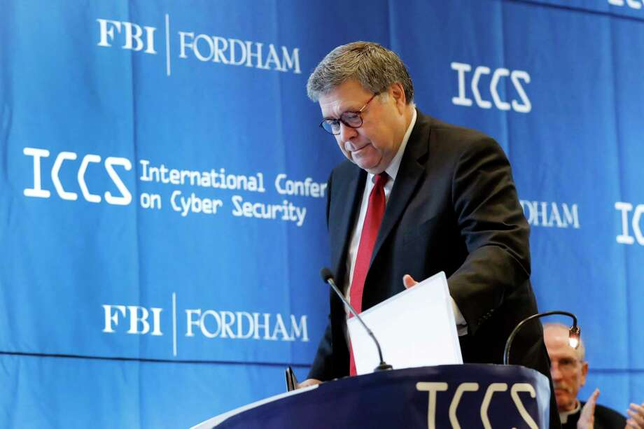 U.S. Attorney General William Barr approaches the podium to address the International Conference on Cyber Security, hosted by the FBI and Fordham University, at Fordham University in New York, Tuesday, July 23, 2019. (AP Photo/Richard Drew) Photo: Richard Drew, STF / Associated Press / Copyright 2019 The Associated Press. All rights reserved.