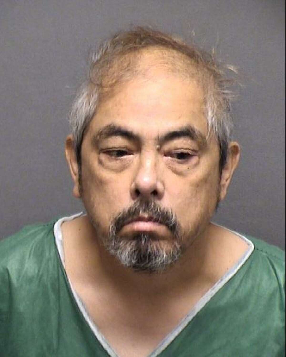Lindsey Turiano, 58, is seen in a booking photo after he was arrested Wednesday Aug. 21, 2019, and charged with murder in the death of his mother, 89-year-old Norma Woods.